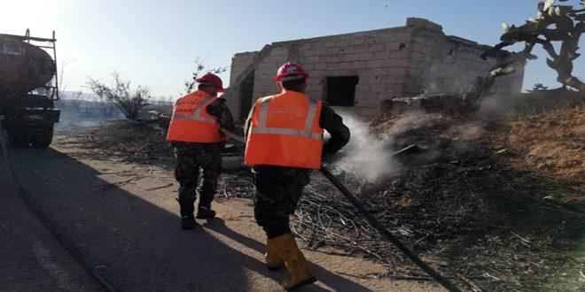 إخماد حريقين نشبا في حقول الزيتون والقمح والسرو بريف حمص