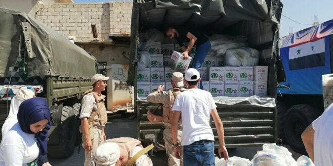 العسكريون الروس يسلمون 4.6 ألف طن من المواد الغذائية إلى السوريين