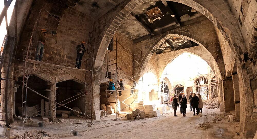 حلب... إعادة سوق مدمر إلى ما كان عليه قبل مئات السنين... صور وفيديو