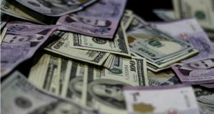 قرار المركزي برفع سعر صرف الدولار